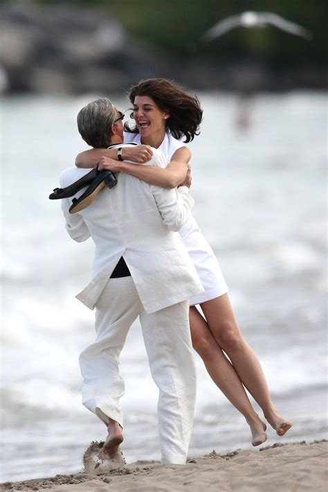 Katie Holmes Giddily Channels Jackie O