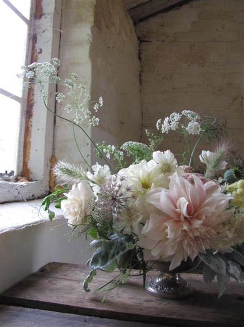 Stunning dahlia flower arrangement in a compote vase by