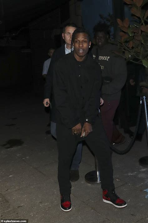 A$AP Rocky sparks up a suspicious looking cigarette while